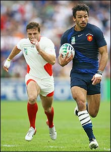 Clement Poitrenaud runs in to score France's opening try