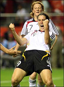 Birgit Prinz celebrates after scoring Germany's opener