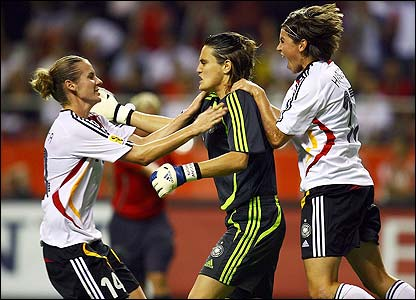 Angerer is mobbed by her team-mates