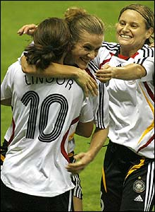 Germany's Simone Laudehr celebrates with team-mates after scoring the second