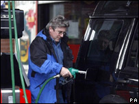 Motorist fills up his car with petrol