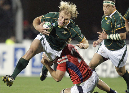 Schalk Burger beats a tackler