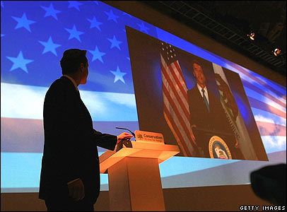 California's Republican Governor Arnold Schwarzenegger gives a speech via video link to the Conservative Party conference in Blackpool