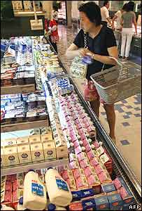 Chinese woman shopping for milk in Shanghai supermarket