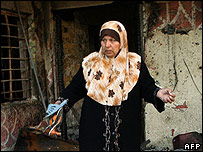 Iraqi woman collects belongings from her house after 27 Sept car bomb attack in Baghdad