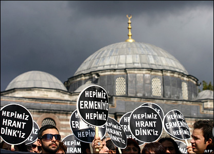 """Demonstrators hold placards reading """"We are all Hrant Dink"""" and """"We are all Armenians"""" in Turkish during a protest outside a court in Istanbul, Turkey"""