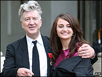 David Lynch leaving the Elysee Palace with actress Emily Stofle