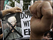 A picture of North Korean leader Kim Jong-il is defaced at a rally in Seoul - 01/09/07
