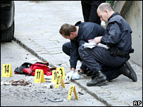Police investigate a backpack containing grenades, explosives and nails near the US embassy in Vienna, Austria