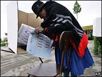 Ecuadorean woman consults the ballot paper