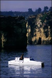 Pedal boat Moksha departing Lagos, Portugal - passing Cape St.Vincente, October 1994. Copyright (Expedition 360.com)