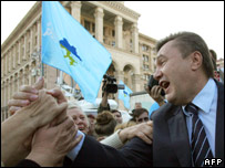 Viktor Yanukovych greets supporters during a Regions Party rally on Independence Square in Kiev