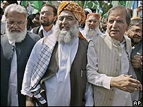 Opposition legislators led by Maulana Fazal-ur-Rehman (centre) march towards the National Assembly