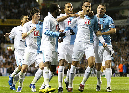 Dimitar Berbatov is mobbed by his team-mates