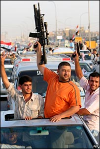 Mahdi Army militiamen celebrate the withdrawal of UK troops from Basra