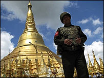 A Burmese soldier patrols Rangoon's landmark Shwedagon Pagoda on 2 October