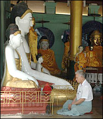 A man prays at Shwedagon pagoda in Rangoon, Burma