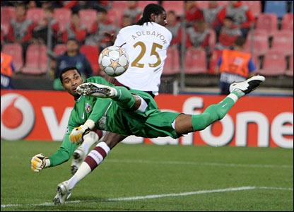 Steaua goalkeeper Robinson Zapata denies Emmanuel Adebayor