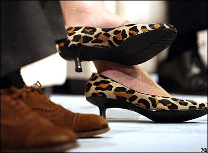 Theresa May's leopard print shoes next to Ken Clarke's traditional brown suede shoes