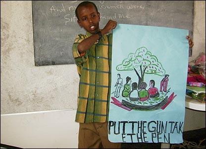Somali boy holding a poster