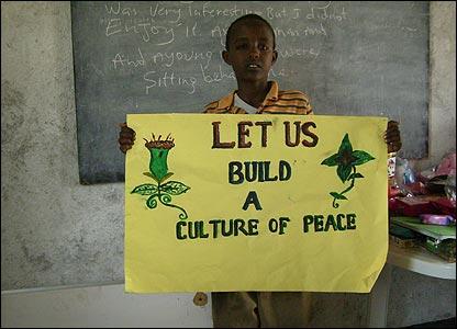 Somali boy Mustafa holding a poster