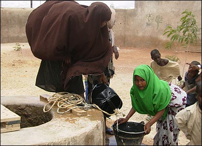Somali girls getting water from a well