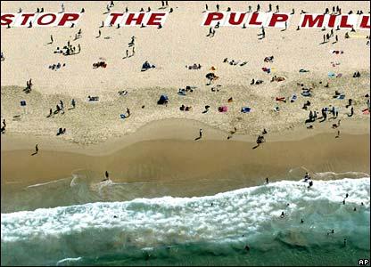A dramatic protest environmentalists' banner on Sydney's Bondi Beach