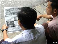 Customers at a Rangoon tea shop share a newspaper on Wednesday