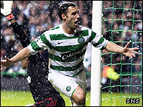 Scott McDonald celebrates his late winner for Celtic