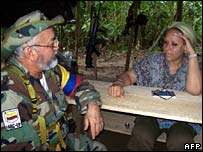 Senator Piedad Cordoba, right, meets with Farc commander Raul Reyes in the Colombian jungle on 14 September
