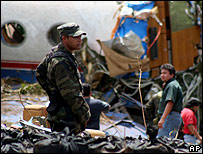 Mexican soldier guards the crashed plane