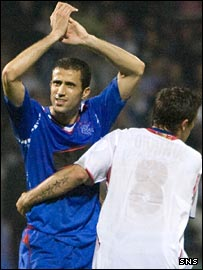 Brahim Hemdani and Nacho Novo celebrate Rangers' victory in Lyon