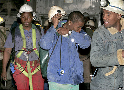 Miners leave the mine during Wednesday night