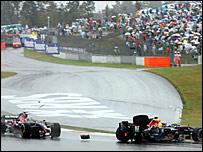 Sebastien Vettel's Toro Rosso (left) collides with Mark Webber's Red Bull
