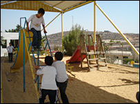 Hope Flowers School playground, with hilltop of Efrat in background