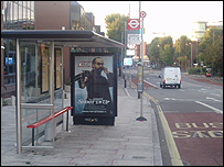 A poster for Shoot Em Up at a bus stop in west London