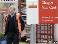 Royal Mail worker walking out of work