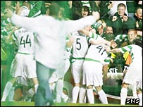 The fan runs on to the pitch during Celtic's goal celebrations