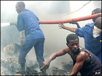 Rescue workers at the scene of a plane crash in Kinshasa, Congo, on Thursday