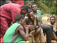 Mbendjele pygmies using a hand-held mapping device