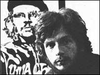 A young Jim Fitzpatrick sits in front of one of the original Che posters