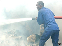 A firefighter at the scene of the plane crash