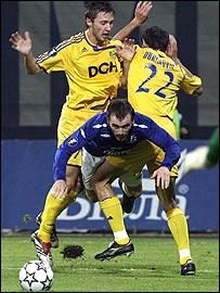 Everton's James McFadden is brought down against Metalist Kharkiv