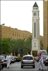 Saudis walk past Justice Square in Riyadh (July 2004)