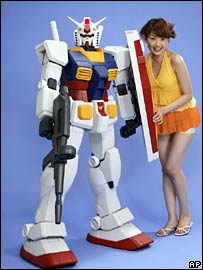A model poses next to a plastic model of one of the robots in series Gundam (file image)