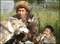 Evenki hunter and son with dog