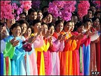 North Koreans wave at the motorcade of South Korean President Roh Moo-hyun
