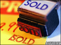 "A rubber stamp reading ""sold"""