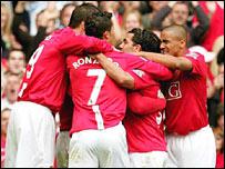 Man Utd celebrate Carlos Tevez's goal
