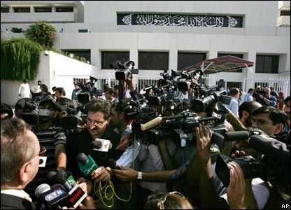 Media surround a Pakistani lawmaker in Islamabad